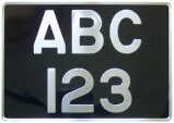 Old style motorcycle number plate